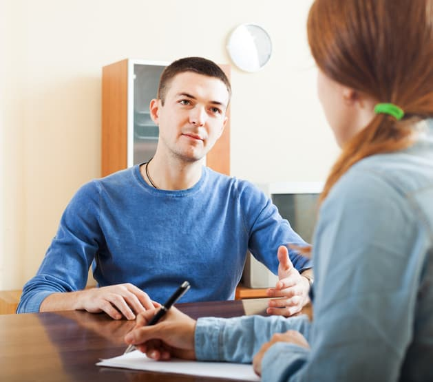 Ordinary man  questionnaire for social worker or employee at table