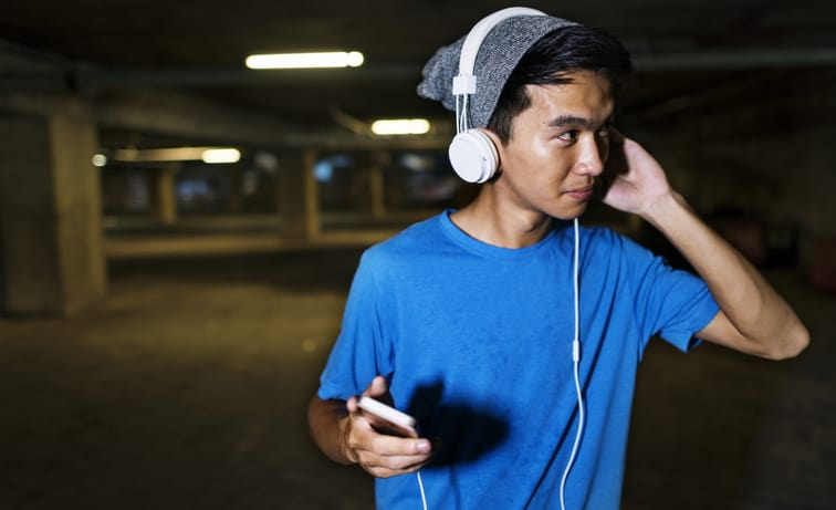 Young guy listening to music